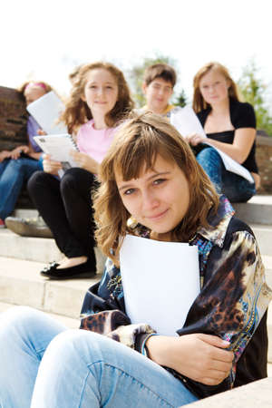 A group of smiling teens sitting on stairs Stock Photo - 7801689