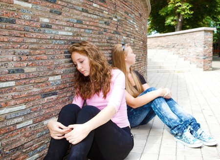 Two attractive teen friends in quarrel photo
