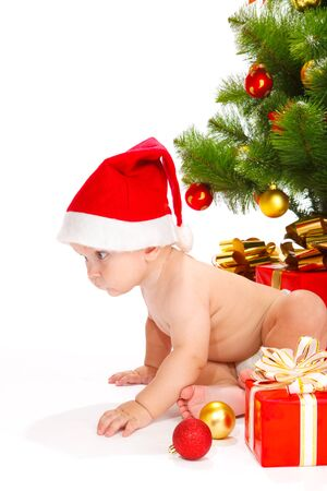 interested baby: Kid in Cristmas hat crawling
