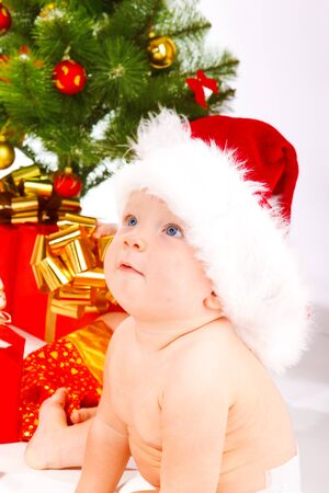 Baby in xmas hat looking up Stock Photo - 7848380