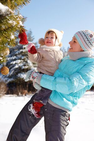 Mother and toddler girl decorating Christmas tree Stock Photo - 7848384