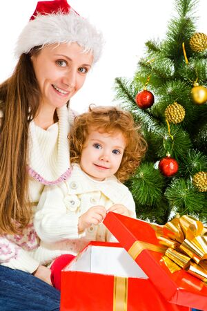 Mother and little daughter opening a present box Stock Photo - 7872209