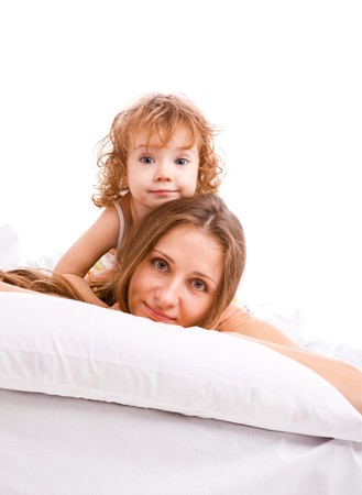 Beautiful mother and daughter lying on the pillow Stock Photo - 7872197