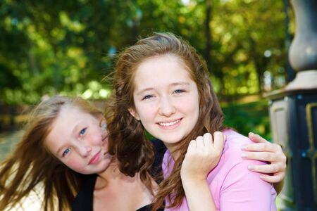 Teenage sisters laughing  photo