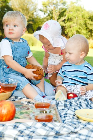 Kids having picnic in the outdoor photo