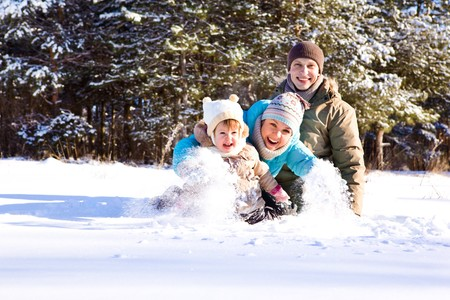Attractive family having fun in a winter park Stock Photo - 7872200