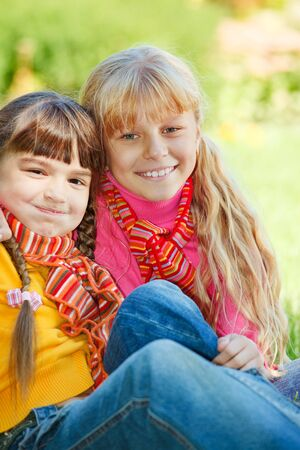 Smiling kids with striped scarves on photo