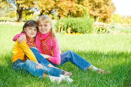 Lovely girls embracing photo