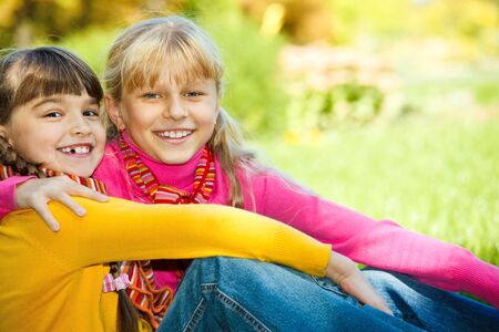 Smiling girls with bright scarves on photo
