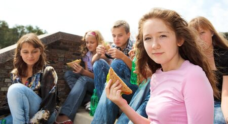 Teens eating take away food photo