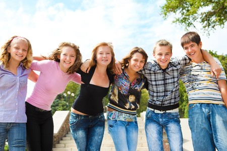 Teenage group embracing photo