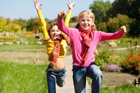 Happy girls running Stock Photo