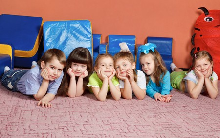 A group of preschool kids on the floor photo