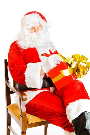 Santa Claus making notes on a present box photo