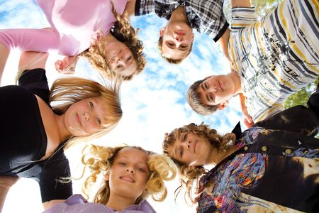 young youth: Group of cheerful friends embracing