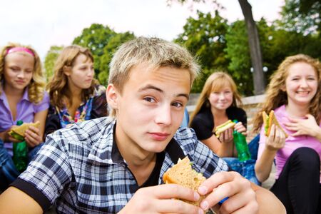 bread soda: Teenager group with take-away food Stock Photo