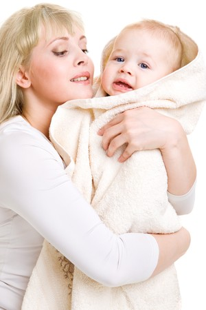 Mom embracing her beautiful baby son covered with towel photo