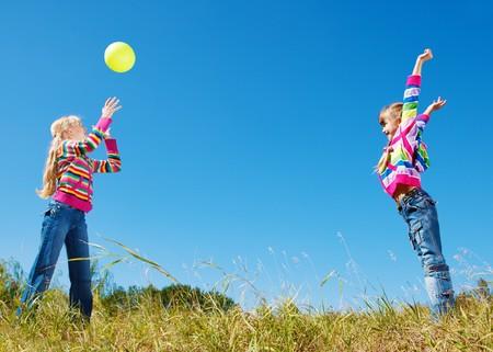 Teenage girl catching the ball photo