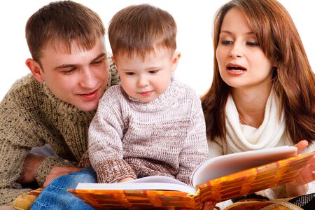 Portrait of young parents and son reading photo