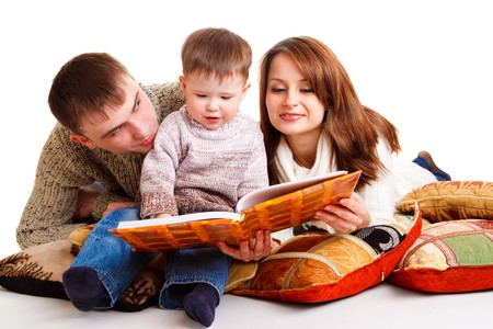 Young mom and dad reading for the kid photo