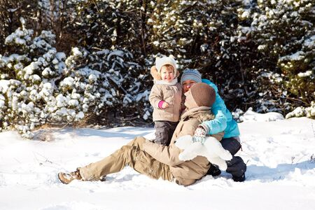 Young family having fun in snow photo