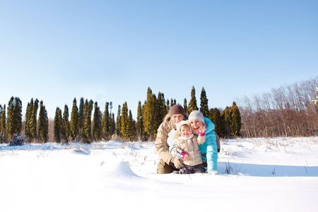 Cheerful family in snow photo