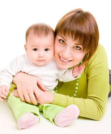 Cheerful mother embracing infant photo