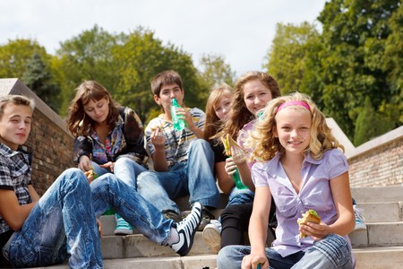 drinking soda: Teens eating sandwiches