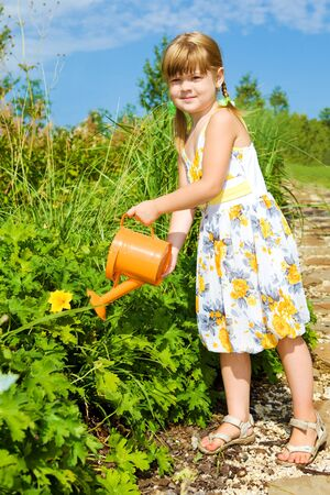 Preschool girl with a watering can Stock Photo - 7955223