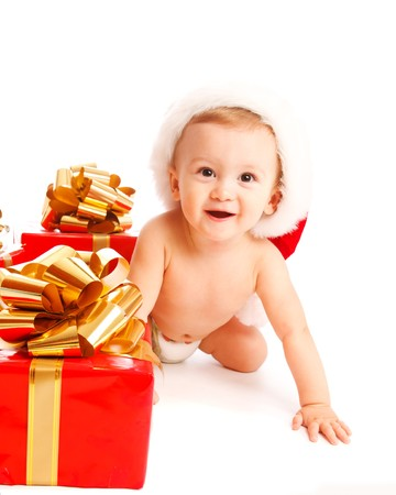 Joyful kid crawling beside Christmas present boxes photo