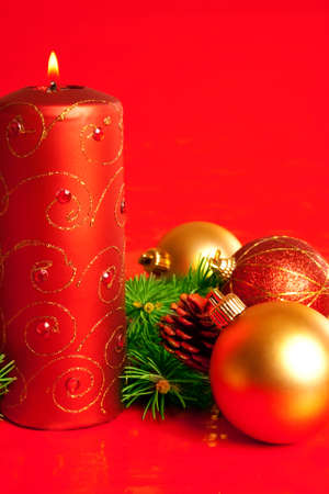 Christmas candle with cone and decoration photo