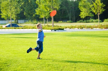 Preschool boy throwing plastic disc Stock Photo - 8013159