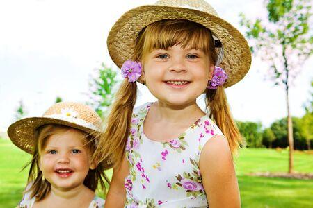 Preschool girls in straw hats photo