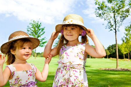 Two sweet kids in straw hats Stock Photo - 8013192