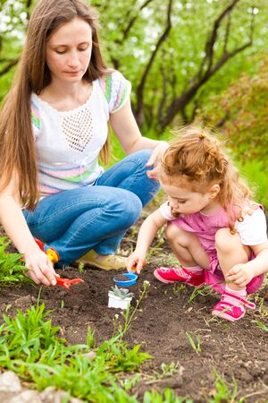 Mother and daughter working in garden Stock Photo - 8013304