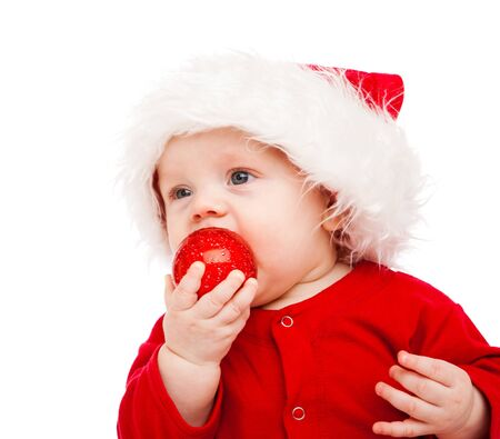 Baby with Christmas decoration in hand photo