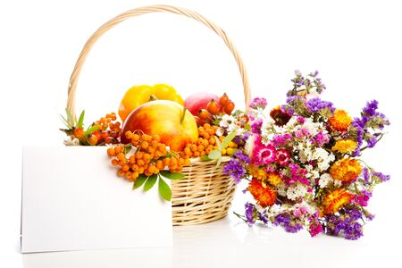 Basket with autumn fruit and vegetables, blank card photo