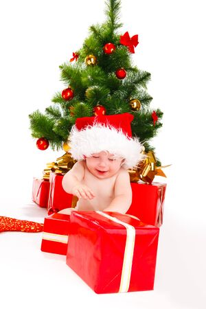 Baby unpacking Christmas presents Stock Photo - 8168537