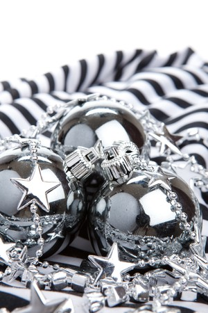 Silver Christmas baubles on striped background photo