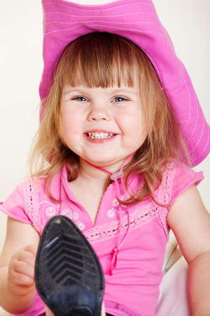 Cheerful girl in pink cowboy hat photo