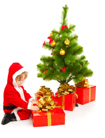Baby in a red santa costume with present box photo