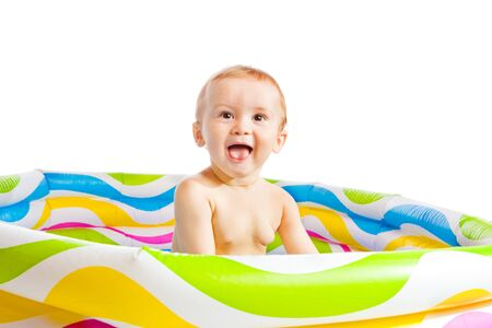 Funny baby boy fun in a rubber pool Stock Photo - 8168514