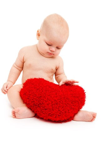 Baby playing with red heart photo