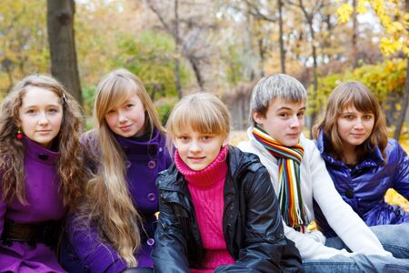 Group of cheerful teens in the fall photo