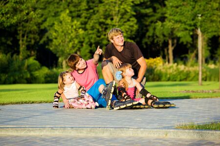 Parents with their girls in park Stock Photo - 8168541