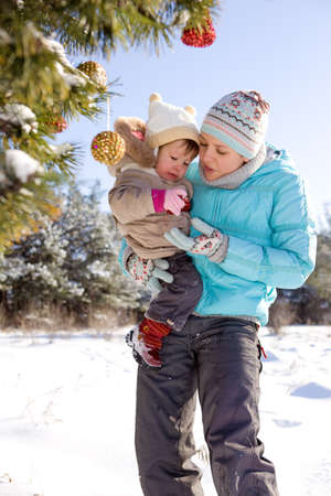 Mother and kid decorating Christmas tree photo