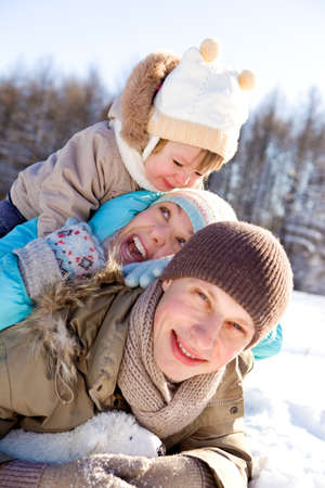 Happy young family enjoying their winter weekend Stock Photo - 8168510