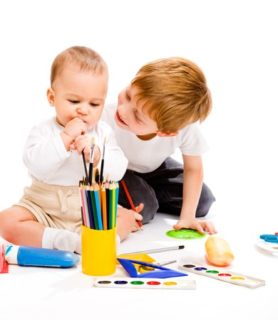 Toddler and preschool boy enjoying art activity photo
