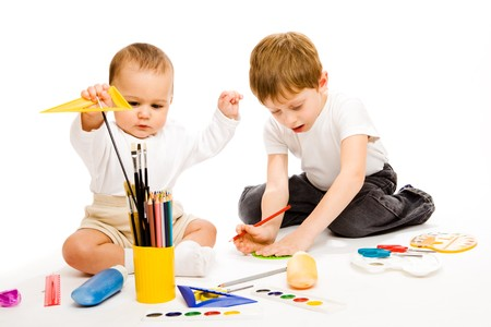 play school: Little and preschool brothers drawing, isolated