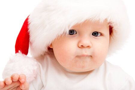 Portrait of a cute baby in a large Santa hat photo